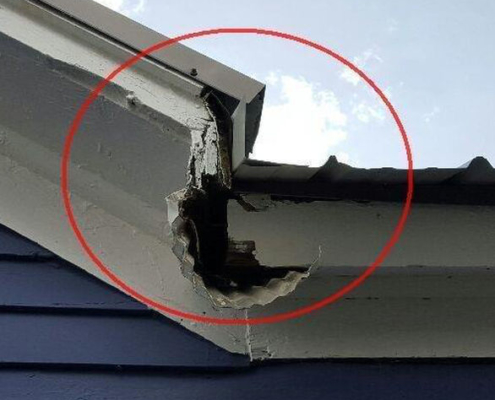 """A very """"creative"""" gutter system to get the water out of a roof after it has already leaked into the attic."""
